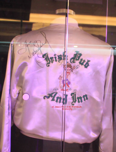 A satin jacket, worn and signed by singer Michael Jackson, is on display at the New World Department Store in Beijing Sept. 8, 2011.