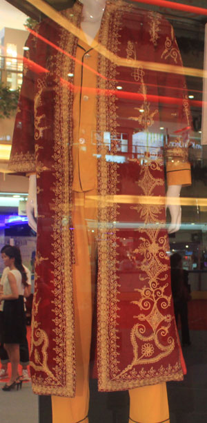 A night gown worn by singer Elvis Presley is on display at the New World Department Store in Beijing Sept. 8, 2011.