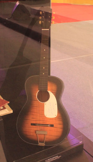 An acoustic guitar signed by singer Elvis Presley is on display at the New World Department Store in Beijing Sept. 8, 2011.