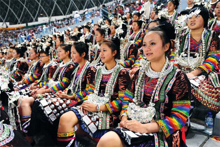 Spectators show up for event the dressed in their native costumes. Zhao Hui / for China Daily