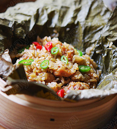 Sticky rice with chicken in lotus leaf, one of the 'top 10 famous Guangzhou dim sums' by China.org.cn.