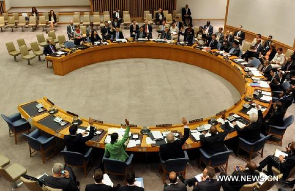 Representatives of member states of the UN Security Council vote in favor of a resolution at the UN headquarters in New York, the United States, Sept. 16, 2011. The UN Security Council on Friday unanimously adopted a resolution to ease sanctions against Libya's assets and arms. [Xinhua]
