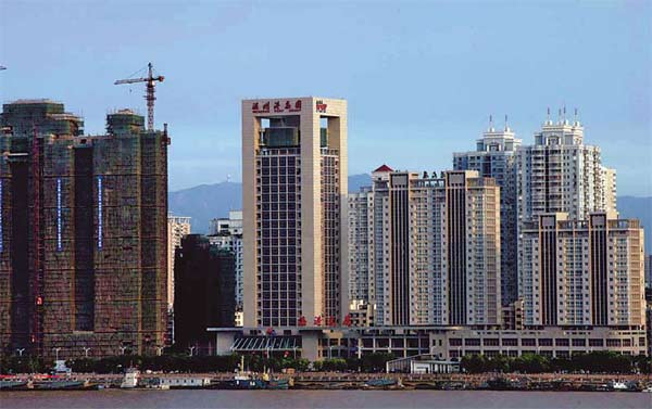l estate projects under construction in Wenzhou, Zhejiang province. Many local developers have turned to underground financing as China tightens bank lending policies. [China Daily]