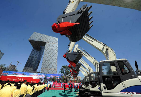Photo taken on Sept. 19, 2011 shows the ceremony for the beginning of the construction of the city's tallest skycraper in Beijing, capital of China.