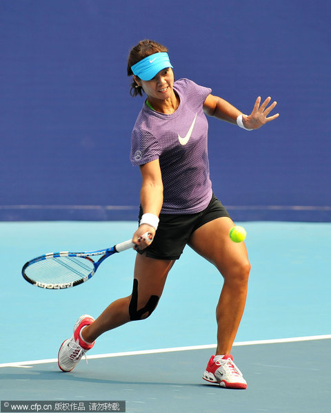 Li Na and her husband, Jiang Shan, practiced at Lotus Court to warm up for the upcoming China Open on 25 September, 2011.