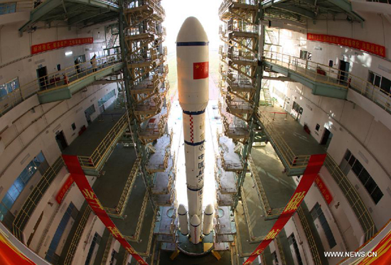 A Long March 2F carrier rocket loaded with 'Tiangong-1', China's unmanned space module, is moved to the launch pad at the Jiuquan Satellite Launch Center in northwest China's Gansu Province, Sept. 9, 2011.