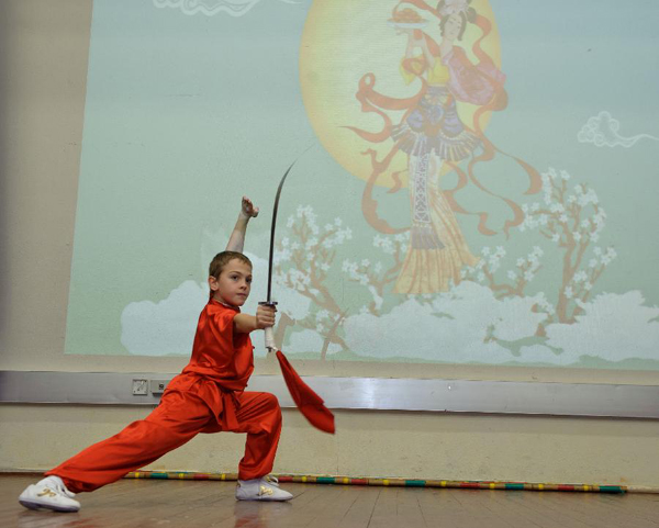A student performs Chinese Gongfu during a Chinese language culture festival in Moscow, Russia, Sept. 24, 2011. A Chinese language culture festival was held in the 1948 School in Moscow, attracting Chinese middle school students and pupils living in Moscow and Russian students who loved Chinese culture to attend.