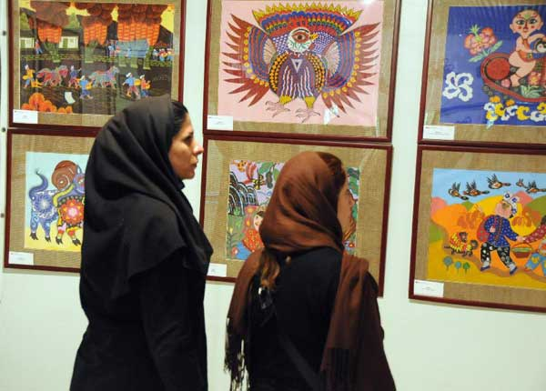 Two Iranian women look at paintings by Chinese peasants at an exhibition during the Chinese Culture Week in Tehran, capital of Iran, Sept. 25, 2011. The Chinese Culture Week kicked off here on Thursday to mark the 40th anniversary of the establishment of the diplomatic ties between China and Iran.