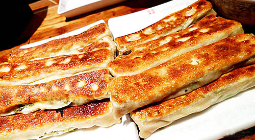 Fried wheaten pancake with fillings, one of the 'top 10 famous Beijing snacks' by China.org.cn.