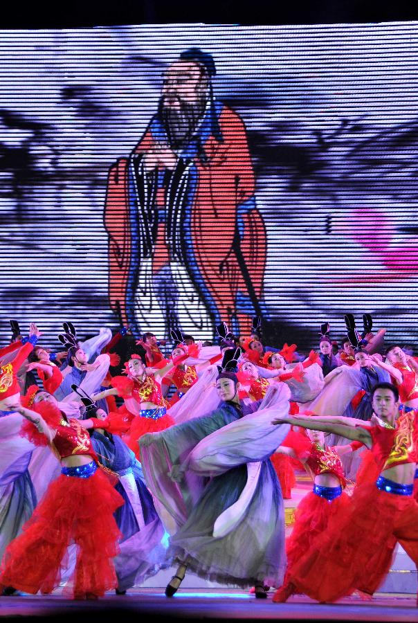 Actors perform during a dancing opera about Confucius (551-497BC), a Chinese thinker, educationist and philosopher, in Qufu, Confucius' hometown in east China's Shandong Province, Sept. 27, 2011.