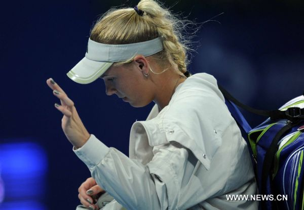 Denmark's Caroline Wozniacki leaves the court after the women's singles quarterfinal against Italy's Flavia Pennetta at 2011 China Open Tennis Tournament in Beijing, capital of China, on Oct. 7, 2011. Wozniacki lost the match 1-2. [Gong Lei/Xinhua]
