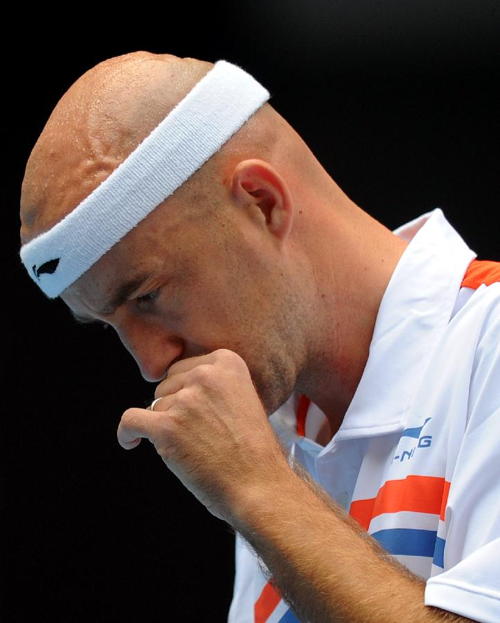 Croatia's Ivan Ljubicic reacts during the men's singles semifinal against his compatriot Martin Cilic at the 2011 China Open Tennis Tournament in Beijing, capital of China, on Oct. 8, 2011. Ljubicic failed to enter the final after losing the match 0-2. [Gong Lei/Xinhua]
