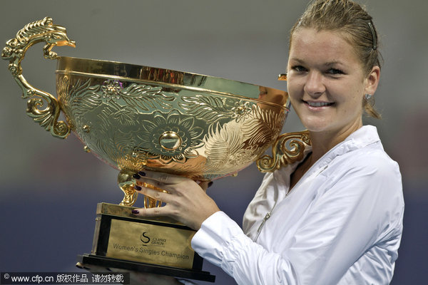 Poland's Agnieszka Radwanska holds her trophy after defeating Germany's Andrea Petkovic in the women's singles final of the China Open Tennis Tournament at the national stadium court in Beijing, Sunday, Oct. 9, 2011.