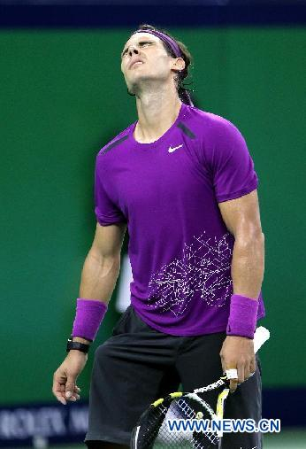 Rafael Nadal of Spain reacts while playing against Florian Mayer of Germany at the 2011 Shanghai Rolex Masters tournament at the Qizhong Tennis Center in Shanghai, east China on Oct. 13, 2011. Mayer won 2-0. [Fan Jun/Xinhua]