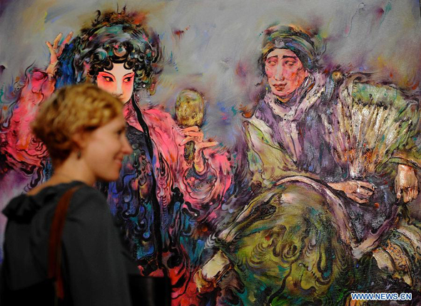 A woman visits the Selected Works of Chinese Oil Paintings Exhibition at the UN headquarters in New York, Oct. 17, 2011. More than 20 works of Chinese artist Liu Linghua were shown at the exhibition, which would last from Oct. 17 to 27.