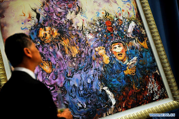 A visitor views a painting in the Selected Works of Chinese Oil Paintings Exhibition at the UN headquarters in New York, Oct. 17, 2011. More than 20 works of Chinese artist Liu Linghua were shown at the exhibition, which would last from Oct. 17 to 27.