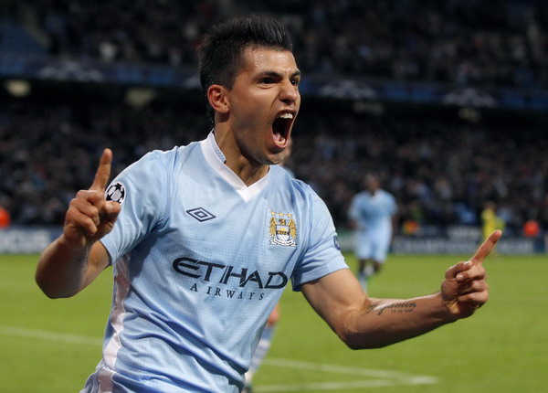 Late Aguero winner sends Man City wild