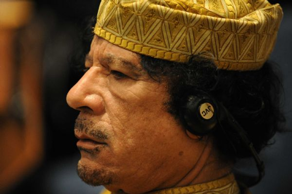 File photo taken on Feb. 2, 2009 shows Muammar Gaddafi reacting during the opening ceremony of the 12th AU Summit in Addis Ababa, capital of Ethiopia. [Xu Suhui/Xinhua]