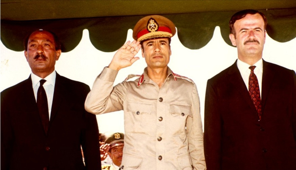 Former Libyan leader Muammar Gaddafi[Middle] when he is young
