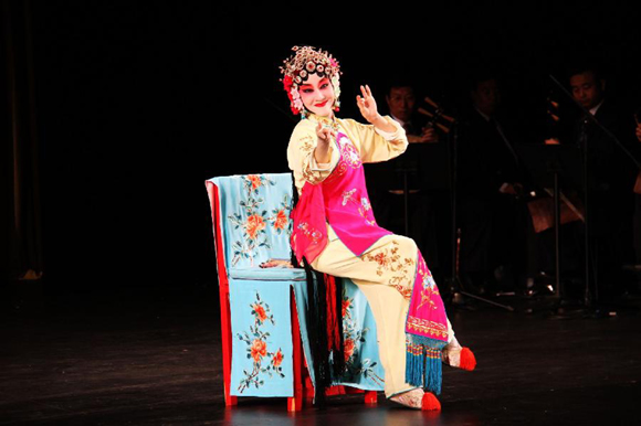 An actress of China's Tianjin youth Beijing opera troupe performs during the Chinese film cultural week at Long Beach University in California, the United States, Oct. 20, 2011. The Chinese film cultural week, opened on Thursday in California, would show eight movies to U.S. audiences.