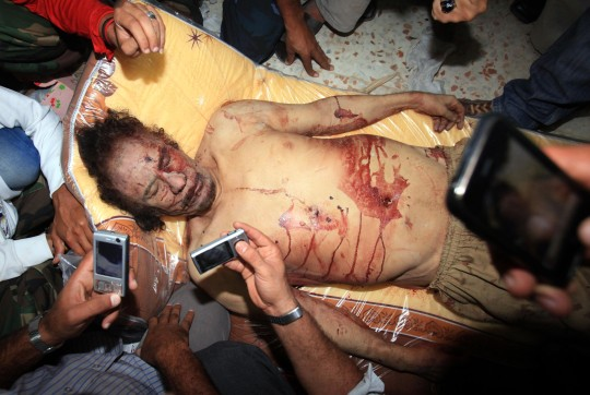 The photo taken on Oct. 21, 2011 shows the body of former Libyan leader Muammar Gaddafi in Misrata, Libya.