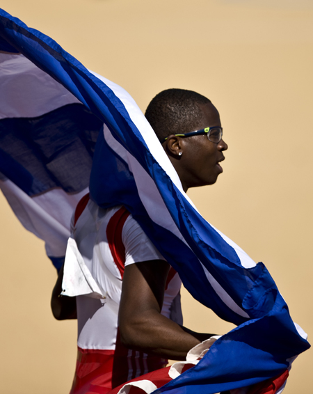 Dayron Robles of Cuba celebrates after winning the gold medal of the men's 110m hurdles final competition during the Pan American Games Guadalajara 2011, at Telmex Athletics Stadium, in Zapopan, Jalisco, Mexico, on Oct. 28, 2011. [Guillermo Arias/Xinhua]