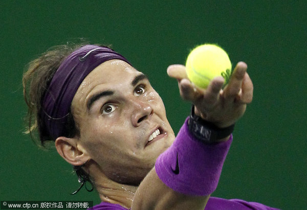 Rafael Nadal of Spain prepares for a service during his third round match against Florian Mayer of Germany at the Shanghai Masters tennis tournament in Shanghai, China on Thursday, Oct. 13, 2011.