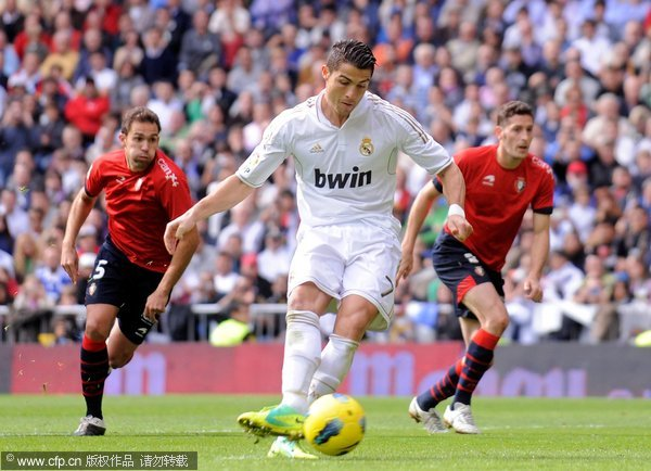 Cristiano Ronaldo of Real Madrid scores his second goal from the penalty spot during the La Liga match between Real Madrid and Osasuna at Estadio Santiago Bernabeu on November 6, 2011 in Madrid, Spain.
