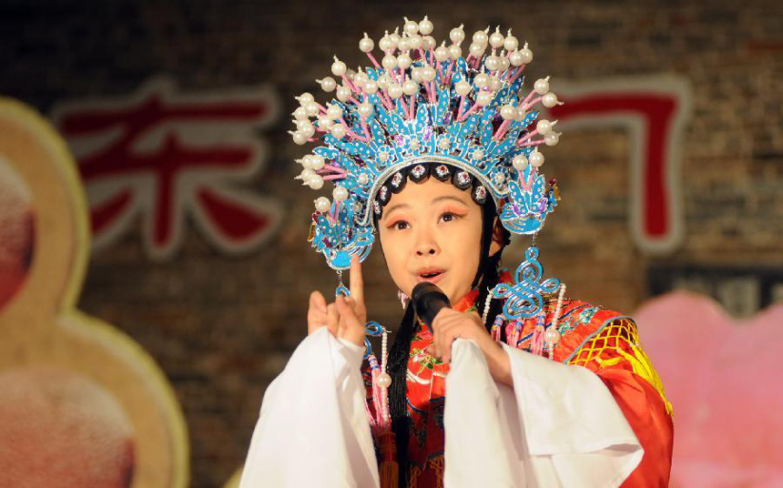 Zhang Xinwen performs a classic play of Peking Opera at Dongmen Drama Stage in Liuzhou City, southwest China's Guangxi Zhuang Autonomous Region, Nov. 4, 2011. As an 11-year-old pupil of Liuzhou Primary School, Zhang Xinwen has been studying Peking Opera for over three years. She fell for the charm of Peking Opera by chance and became a diligent opera fan at the age of eight. Now she dreams of being an Peking Opera actress on a bigger stage.