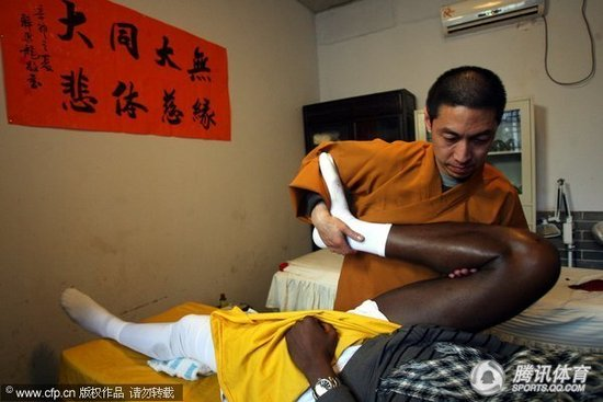 Mikael Pietrus of NBA's Phoenix Suns receives traditional Chinese physical treatment from a monk of the Shaolin Monastery, famous for its mastery in kungfu, or Chinese martial arts.