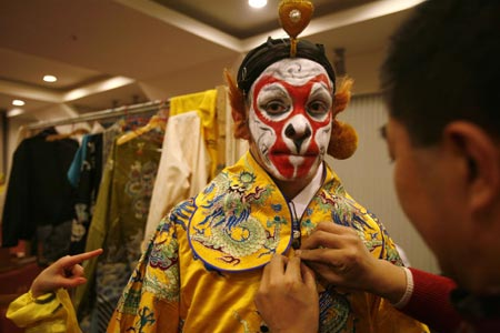 Ghaffar Pourazar of Britain gets dressed before performing in an English version of the traditional Chinese opera Monkey King at a theatre in Shanghai December 8, 2006. Pourazar is the first foreigner to complete the rigorous training at the Beijing Opera School and the National Academy. He is performing with Chinese artists from the International Centre for Beijing Opera, and other troupes, at their first show in Shanghai.