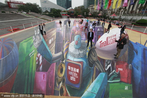 People pose on a 3D picture painted on a square near the Oriental Pearl TV Tower in Shanghai, Nov 9, 2011. The 3D picture covers 1,111 square meters, making it the biggest in China. It is part of an online shopping mall's promotion campaign for a sale that will fall on upcoming 'Single's Day', Nov 11, 2011. [Photo/CFP]