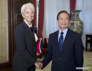 Chinese Premier Wen Jiabao (R) meets with Christine Lagarde, managing director of the International Monetary Fund (IMF), in Beijing, capital of China, Nov. 10, 2011. [Li Xueren/Xinhua]