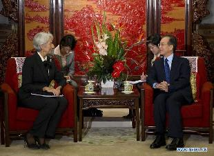 Chinese Premier Wen Jiabao (R, front) meets with Christine Lagarde (L, front), managing director of the International Monetary Fund (IMF), in Beijing, capital of China, Nov. 10, 2011. [Li Xueren/Xinhua]