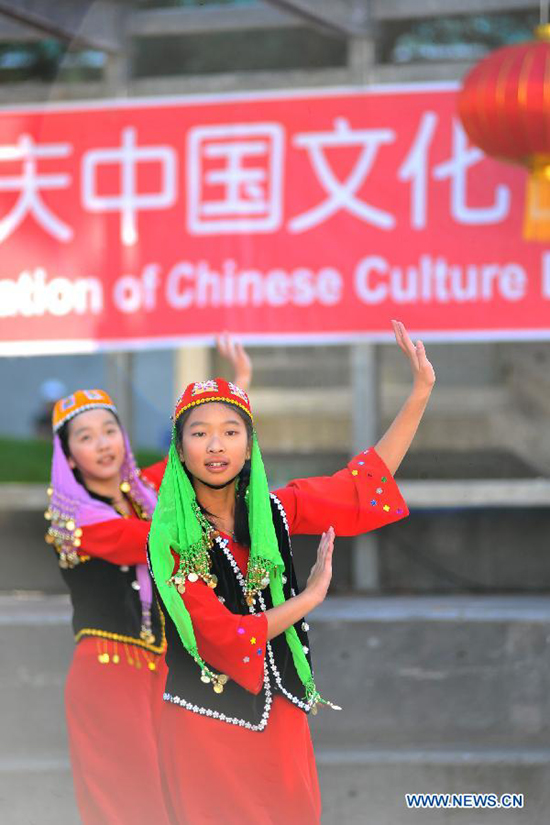 Students perform dance during Chinese Culture Day Celebration at San Francisco State University in San Francisco, the United States, Nov. 14, 2011.
