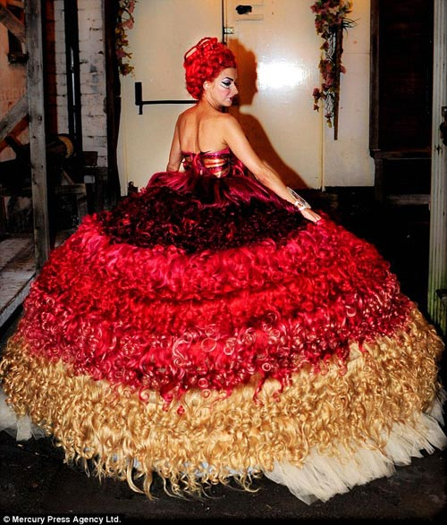 Hair comes the bride: Thelma Madine, who is the dress maker on My Big Fat Gypsy Wedding, has created a wedding gown made of human hair. It weighs 15 stone and is a size 6.