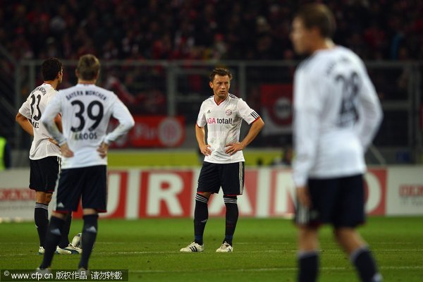 Mario Gomez, Toni Kroos, Ivica Olic and Holger Badstuber of Muenchen react during the Bundesliga match between FSV Mainz 05 and FC Bayern Muenchen at Coface Arena on November 27, 2011 in Mainz, Germany.