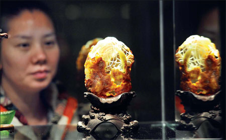 The price of fine nephrite, just natural stone, has climbed from 10,000 yuan a kilogram to at least 1 million in 10 years. Top-grade art work in Hetian jade? Possibly priceless. An exhibit of works such as this in Beijing ended this week. [Provided to China Daily]