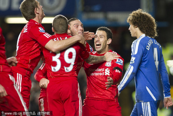 Liverpool's Maxi Rodriguez celebrates with team mates after scoring against Chelsea during their English League Cup quarter final match at the Stamford Bridge stadium in London on Tuesday, Nov. 29, 2011.