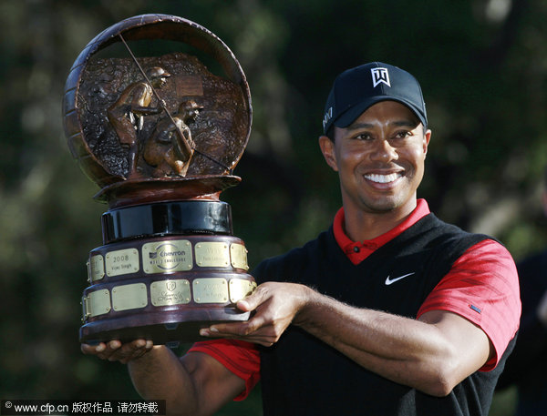 Tiger Woods holds his trophy after winning the Chevron World Challenge Golf tournament at Sherwood country club on Sunday, Dec. 4, 2011, in Thousand Oaks, Calif.