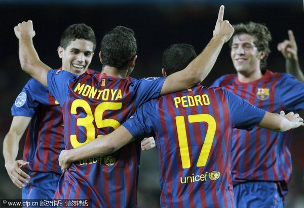 FC Barcelona's player Matin Montoya (2nd-L) celebrates with his teammates after scoring their team's second goal during the Champions League group H soccer match between FC Barcelona and Bate Borisov at the Nou Camp stadium in Barcelona, north-eastern Spain, 06 December 2011.