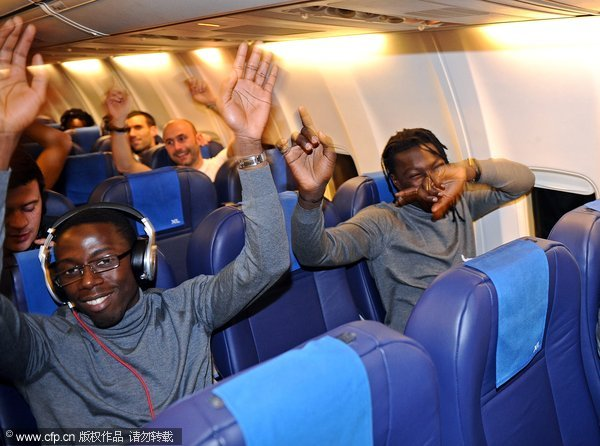 Lyon players are celebrating on their flight after an unlikely 7-1 win over Dinamo Zagreb in UEFA Champions League on December 8, 2011.