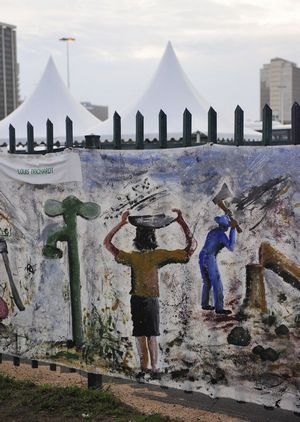 A drawing on the wall near the Durban climate meeting site urges people to save water and stop cutting trees.  [China.org.cn]