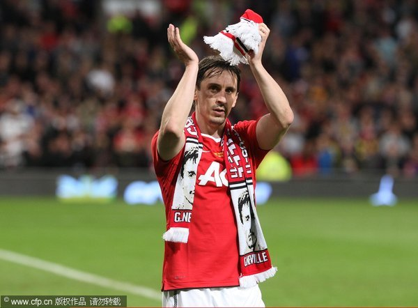 Gary Neville of Manchester United applauds the fans after his testimonial match between Manchester United and Juventus at Old Trafford on May 24, 2011 in Manchester, England.