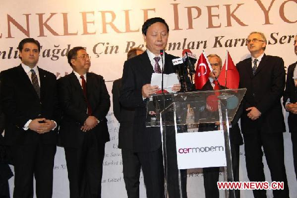 Chinese Vice Minister of Culture Yang Zhijin (1st. L) reads the congratulatory message from Chinese President Hu Jintao at the opening of the '2012 China Culture Year' in Ankara, Turkey, Dec. 12, 2011.