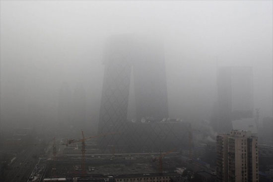 The new China Central Television headquarters building was seen enveloped in heavy fog in Beijing, capital of China on Monday, December 6, 2011. [CFP]