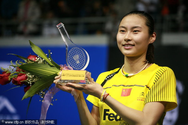 China's world No. 1 Wang Yihan beats India's Saina Nehwal to win the women's singles final of Superseries Finals in Liuzhou on December 18, 2011.