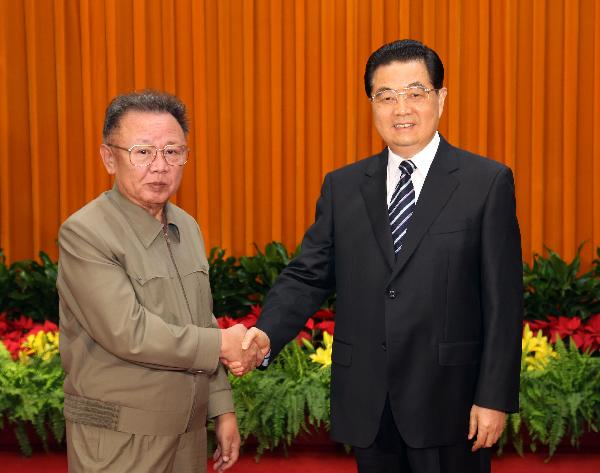 Chinese President Hu Jintao (R) meets with North Korean leader Kim Jong Il at the Great Hall of the People in Beijing on May 5, 2010. [Lan Hongguang/Xinhua]
