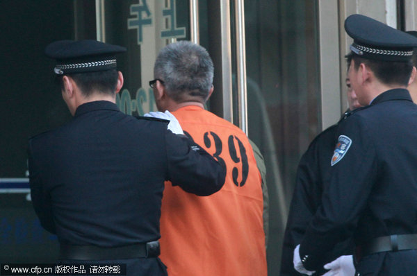  Yang Yimin was brought to court on Wednesday morning.