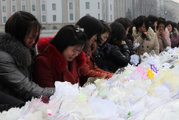 People mourn the death of Kim Jong Il, top leader of the Democratic People's Republic of Korea (DPRK), in Pyongyang, DPRK, Dec. 21, 2011. [Zhang Li/Xinhua]